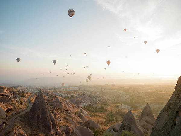 Cappadocia Photograph - Hot Air Balloons Rise Above Desert by Ascent Xmedia