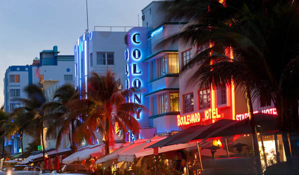 Dade Photograph - Hotels Lit Up At Dusk In A City, Miami by Panoramic Images