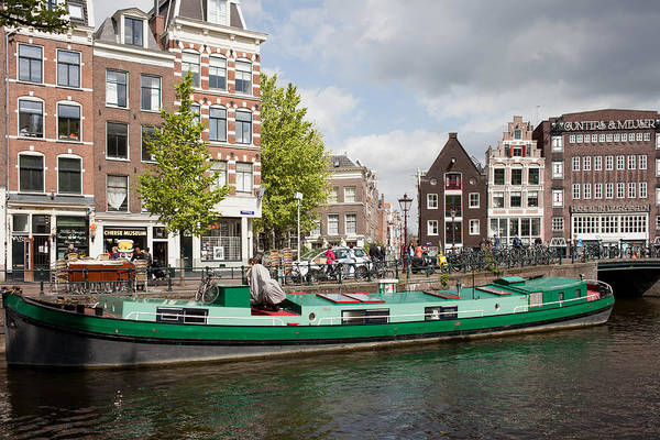 Prinsengracht Photograph - Houseboat On A Canal In Amsterdam by Artur Bogacki