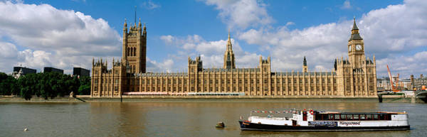 Legislature Photograph - Houses Of Parliament, Water And Boat by Panoramic Images