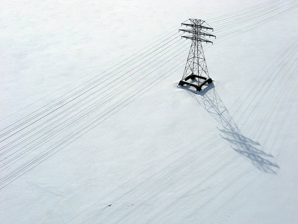 Photograph - Hydro Lines Over A Frozen Ottawa River. by Rob Huntley