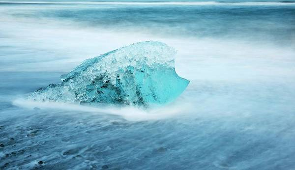 Water Erosion Photograph - Iceberg Melting On A Beach by Jeremy Walker
