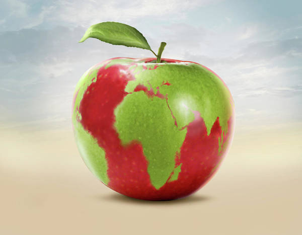 Developing Wall Art - Photograph - Illustration Of An Apple With World Map by Fanatic Studio / Science Photo Library