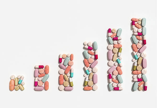 Wall Art - Photograph - Illustration Of Rising Cost Of Prescription Drugs by Fanatic Studio / Science Photo Library
