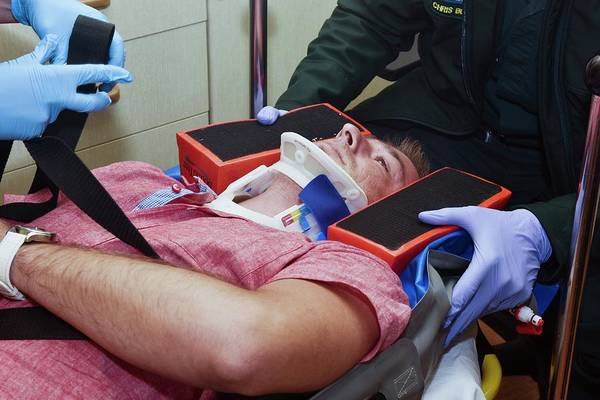 Neck Brace Photograph - Immobilisation Of Patient After Fall by Dr P. Marazzi/science Photo Library