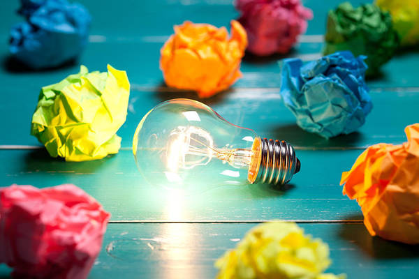 Incandescent Bulb And Colorful Notes On Turquoise Wooden Table Art Print by Xxmmxx
