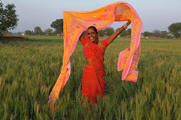 Toothy Smile Photograph - Indian Woman Holding Sari In Wheat Field by Adrian Pope