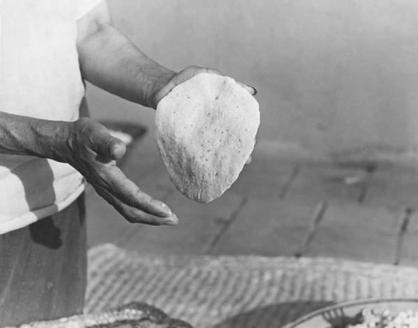 Wall Art - Photograph - Indian Woman Making Tortillas by Underwood Archives Onia