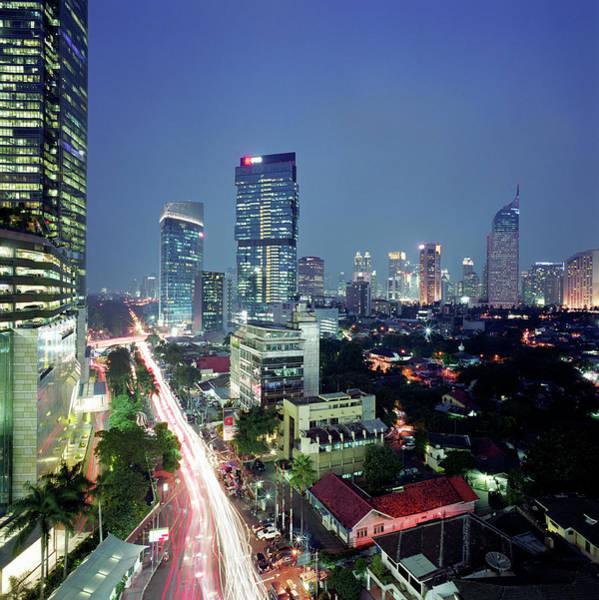 Jakarta Photograph - Indonesia, Jakarta Skyline At Dusk by Martin Puddy