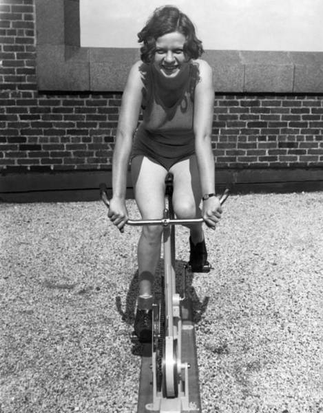 Photograph - Indoor Stationary Bike Race by Underwood Archives