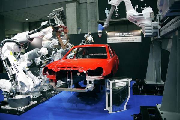 Wall Art - Photograph - Industrial Production Line Robots by Andy Crump/science Photo Library