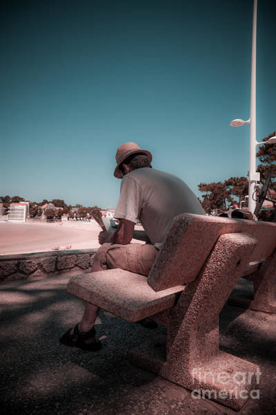 Photograph - One Man Sitting On Shady Bench Overlooking B by Peter Noyce