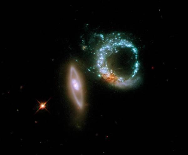 Interacting Galaxies Wall Art - Photograph - Interacting Galaxies Arp 147 by Nasa/esa/stsci/m. Livio/science Photo Library