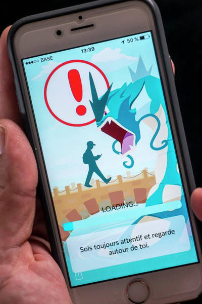 Pokemon Wall Art - Photograph - Interactive Smartphone Game by Danny Gys/reporters/science Photo Library