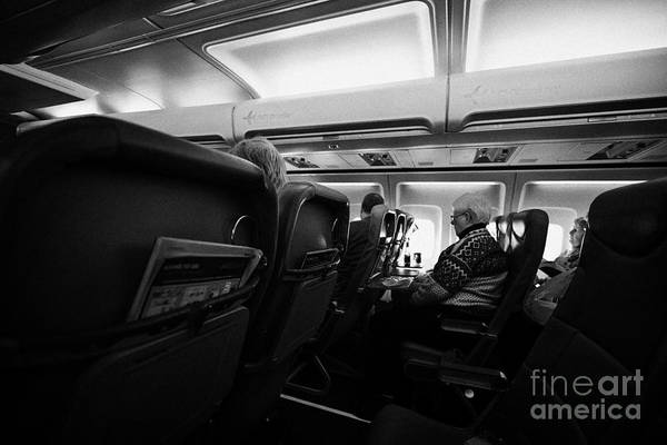 Jet2 Wall Art - Photograph - Interior Of Jet2 Aircraft Passenger Cabin In Flight Europe by Joe Fox