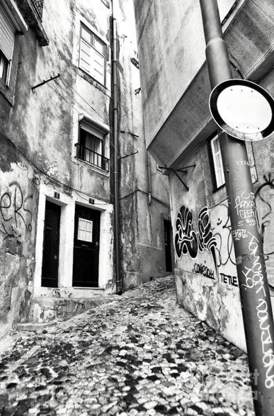 Wall Art - Photograph - Into The Alley by John Rizzuto