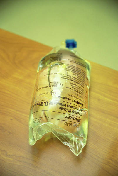 Saltwater Wall Art - Photograph - Intravenous Saline Drip Bag by Antonia Reeve/science Photo Library