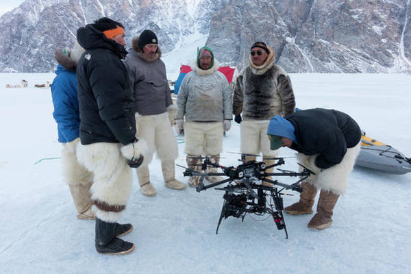 High Definition Photograph - Inuit Hunters With Octocopter Drone by Louise Murray