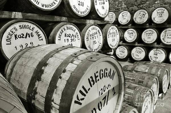 Wall Art - Photograph - Irish Whiskey Matures In Barrels In Lockes Distillery Kilbeggan Ireland by David Lyons