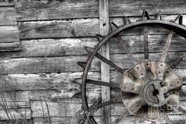 Photograph - Iron Tractor Wheel by Scott Hansen