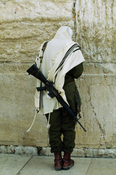 Wall Art - Photograph - Israeli Soldier With Rifle Praying by Paul Chesley