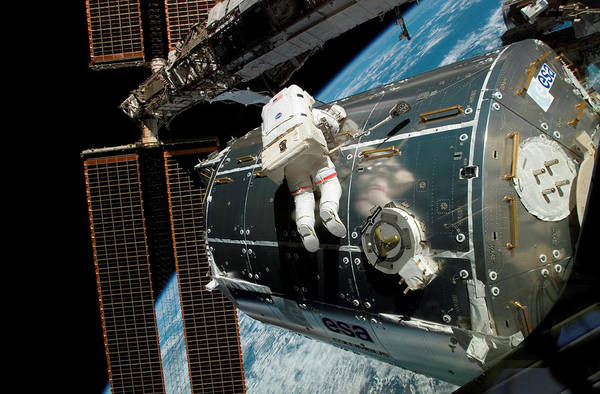 Station To Station Photograph - Iss Columbus Module Installation by Nasa