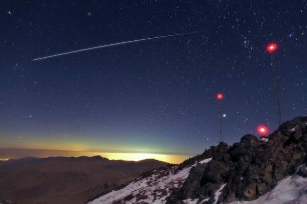 Earth Orbit Photograph - Iss Crossing The Night Sky by Babak Tafreshi