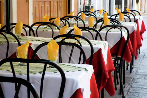 Sidewalk Cafe Photograph - Italy, Venice A Row Of Colorful Tables by Jaynes Gallery