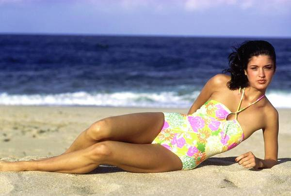 Swimsuit Photograph - Janice Dickinson Wearing A Floral Swimsuit by Arthur Elgort
