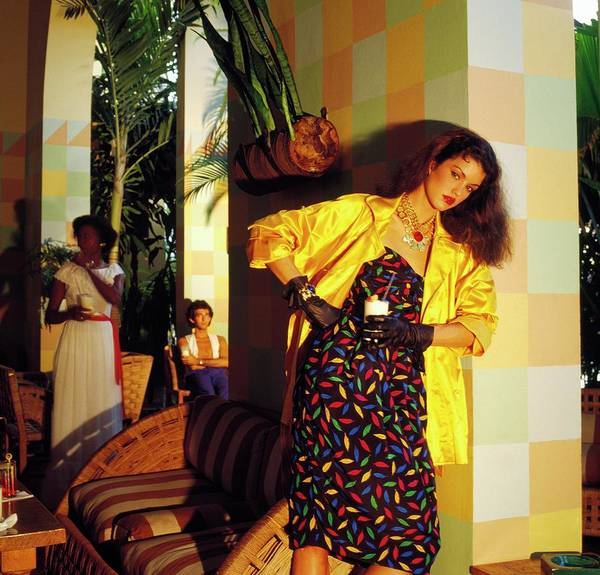 Santos Wall Art - Photograph - Janice Dickinson Wearing Coat And Patterned Dress by Horst P. Horst