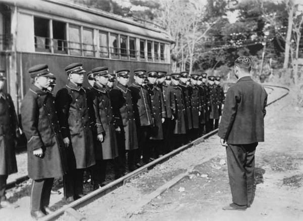 Thoroughfare Photograph - Japanese Street Car Conductors by Underwood Archives
