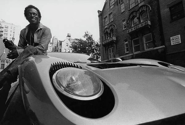 Urban Scene Photograph - Jazz Musician Miles Davis Sitting On The Hood by Mark Patiky