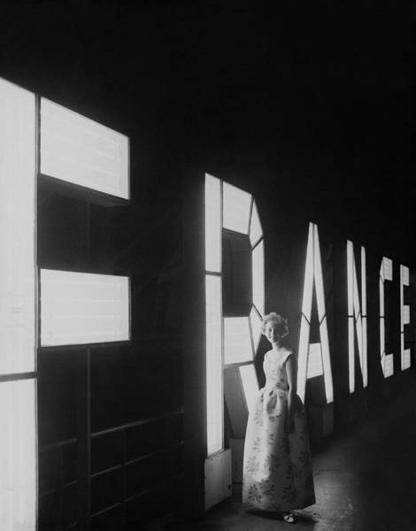 Sign Photograph - Jean Claude Abreu Posing By An Illuminating by Henry Clarke