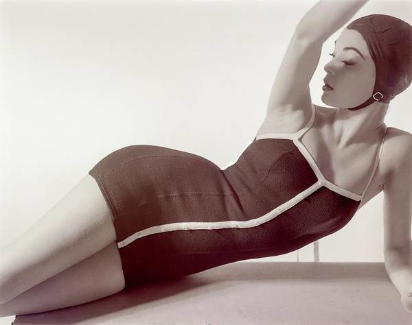 Lying Down Photograph - Jean Patchett Wearing A Sacony Swimsuit by Horst P. Horst