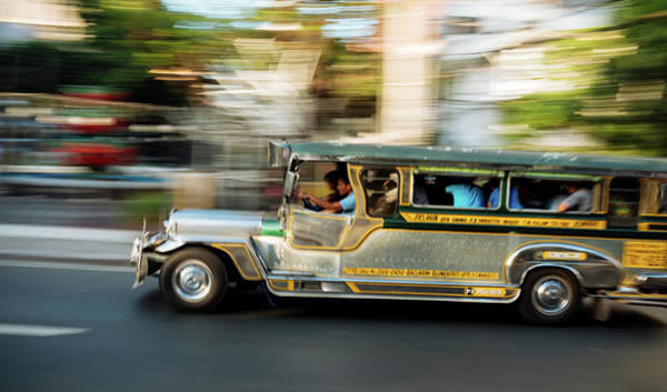 The Philippines Wall Art - Photograph - Jeepney Moving On The Road, Manila by Panoramic Images