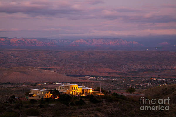 Photograph - Jerome State Park With Red Rocks Of Sedona Arizona In Magic Light by Ron Chilston