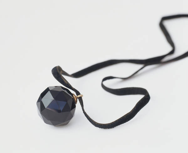 Pendant Photograph - Jet Bauble Threaded On Black Ribbon by Dorling Kindersley/uig
