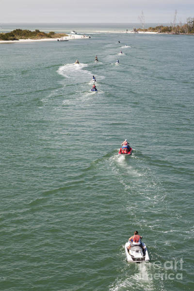 Wall Art - Photograph - Jet Skis Head Out On Estero Bay Towards The Gulf Of Mexico Near Fort Myers Florida by William Kuta