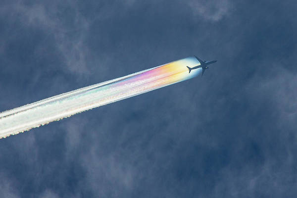 Multi Exposure Photograph - Jetliner With Rainbow Coloured Jet by Lynda Murtha