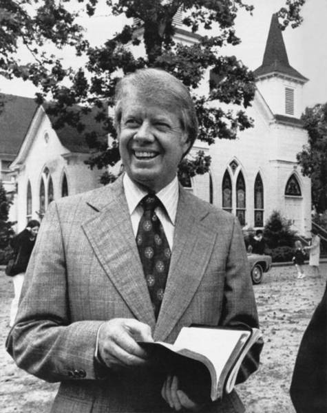 Wall Art - Photograph - Jimmy Carter Holding His Bible by Underwood Archives
