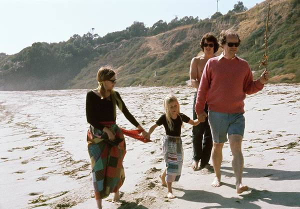 Four People Photograph - Joan Didion And John Gregory Dunne On A Beach by Henry Clarke