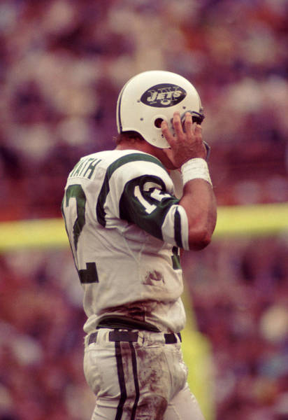 Wall Art - Photograph - Joe Namath Fixing Helmet by Retro Images Archive