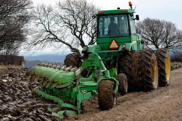 John Deere Photograph - John Deere 8430 Tractor Ploughing by Ian Gowland/science Photo Library