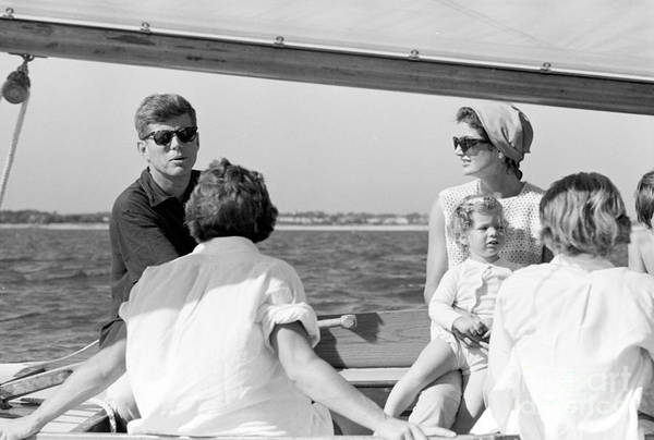 John F Kennedy Photograph - John F. Kennedy And Jacqueline Sailing Off Hyannis Port by The Harrington Collection