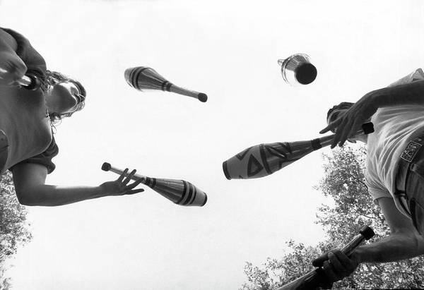 Photograph - Jugglers With Indian Clubs by Underwood Archives