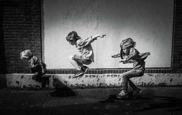 Street Photograph - Jumping Over The Shadows by Gunther Gehlich