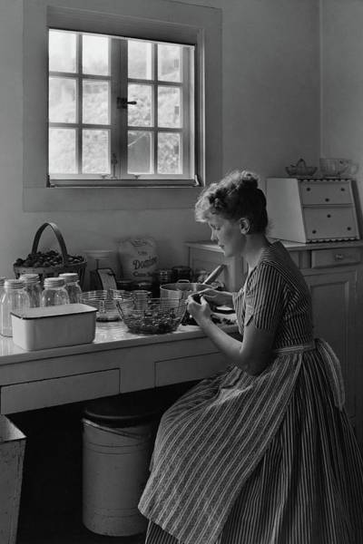 January 1st Photograph - June Plat Preparing Food In Her Kitchen by Samuel H. Gottscho