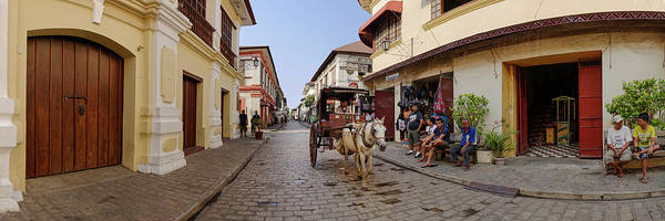 The Philippines Wall Art - Photograph - Kalesa Moving Along Calle Crisologo by Panoramic Images