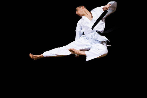 Agile Photograph - Karate Kick by Gustoimages/science Photo Library