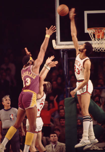 Wall Art - Photograph - Kareem Abdul Jabbar Blocks Wilt Chamberlain by Retro Images Archive